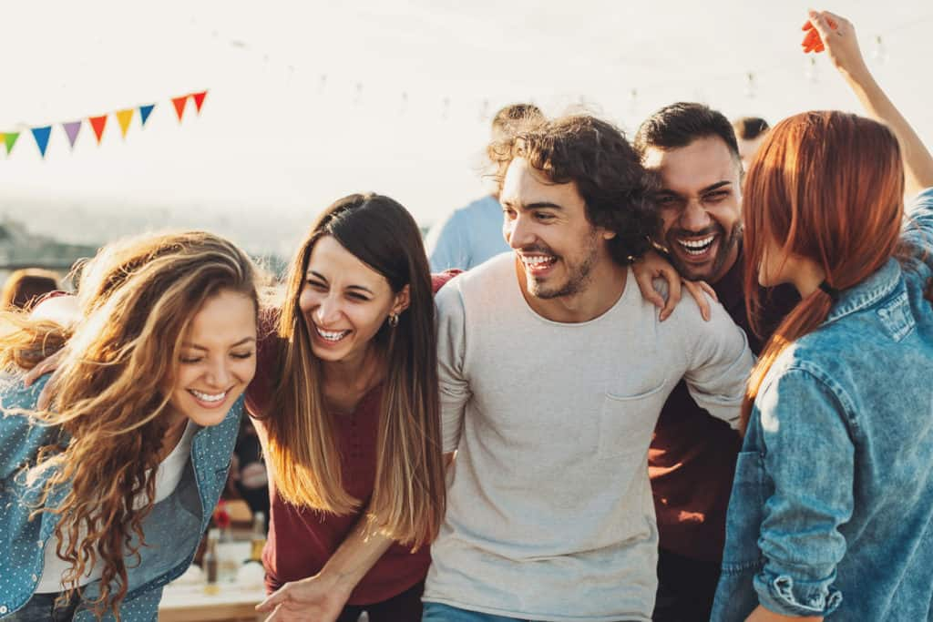 Group of friends laughing together